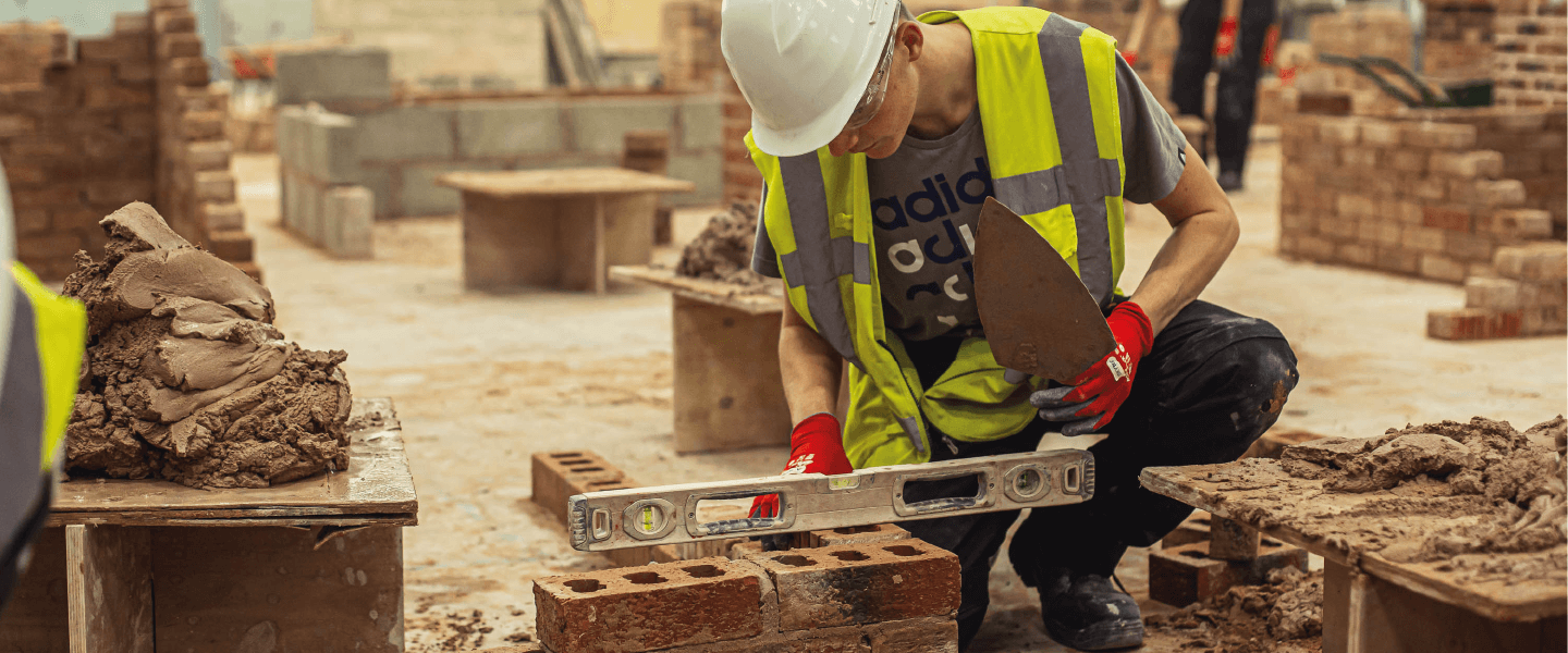 Construction student bricklaying