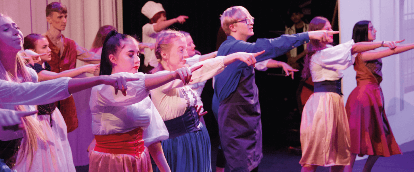 Students performing a musical