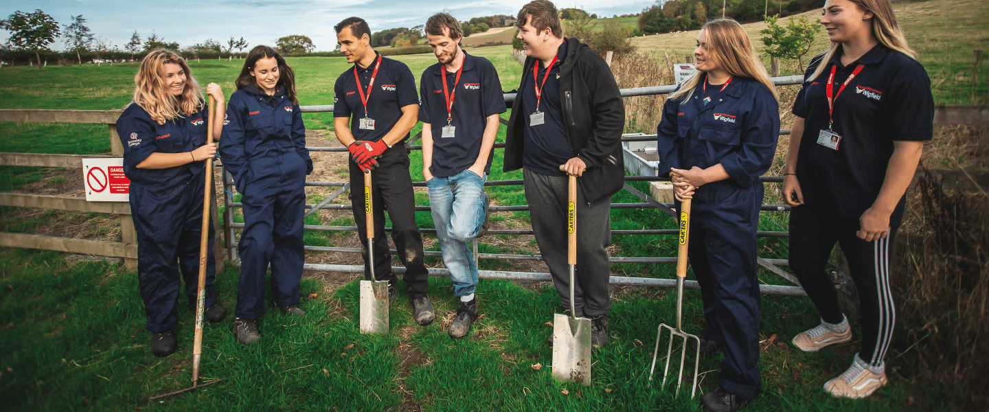 Students at the farm with equipment