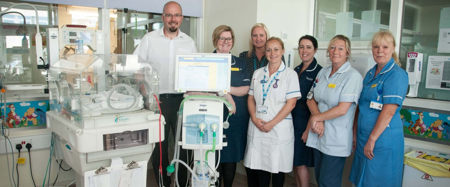 Barnsley College Vice Principal Phil Briscoe with Barnsley Hospital staff on the Neonatal ward.