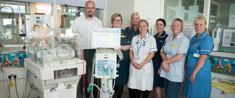 Barnsley College Vice Principal Phil Briscoe with Barnsley Hospital staff on the Neonatal ward.