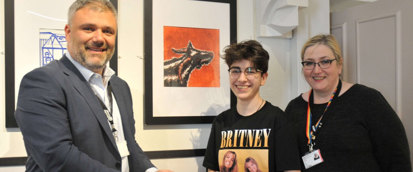 Barnsley College Principal Yiannis Koursis (left), Art and Design student Danya Bilto (centre) and Vice Principal Liz Leek (right) at the Plot to Print exhibition at the Cooper Gallery