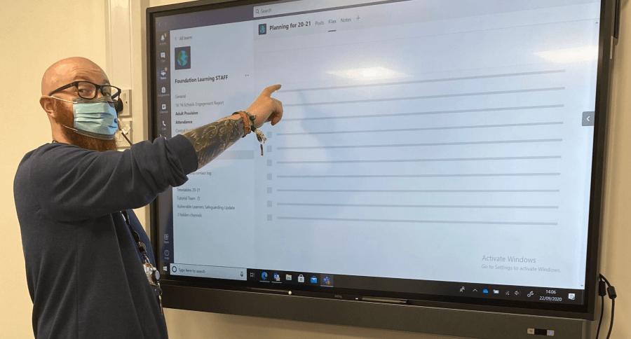 Tutor Matt Sowerby using an interactive screen at The Fleets.