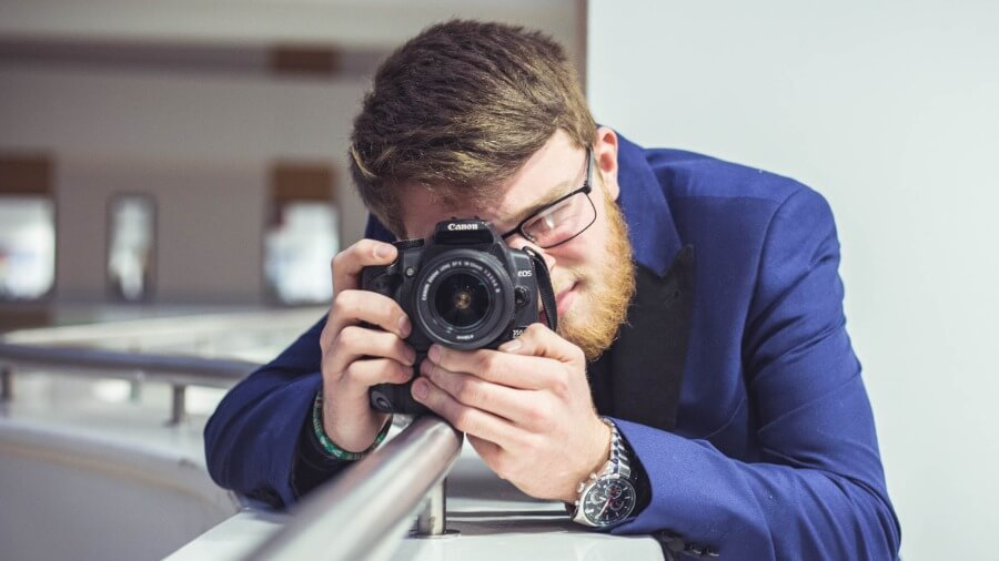 A Barnsley College photography student with a camera.